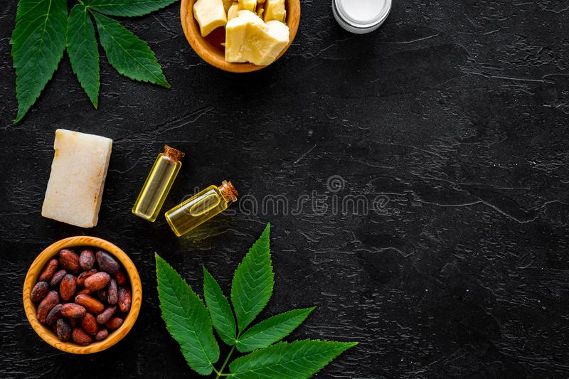 Beautiful composition with cocoa butter cosmetics. Cocoa butter and cocoa beans near soap, cream, oil or lotion in small. Beautiful composition with cocoa butter stock photos