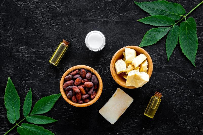 Beautiful composition with cocoa butter cosmetics. Cocoa butter and cocoa beans near soap, cream, oil or lotion in small. Beautiful composition with cocoa butter stock images
