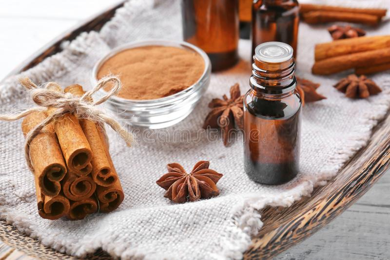 Beautiful composition with essential cinnamon oil in glass bottle stock photos