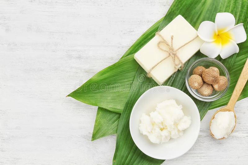 Beautiful composition with shea butter, soap and nuts royalty free stock images