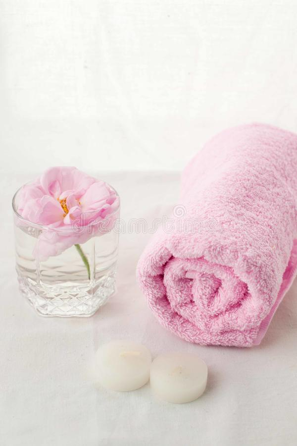Beautiful composition of spa treatment on white tissue background, monochrome pastel concept. royalty free stock image