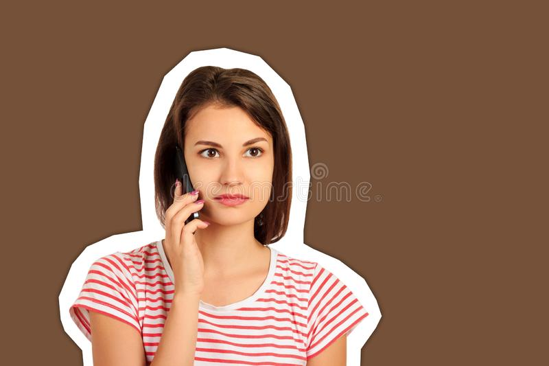 Beautiful concentrated woman talking on mobile phone and hearing bad news. emotional girl Magazine collage style with trendy color stock photography