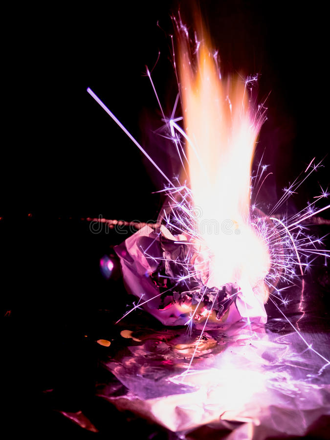 Beautiful concept flames. Fire on burns paper with black background. stock image