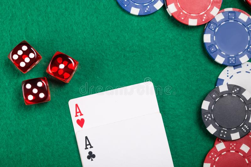 Beautiful concept on a poker table of dice and cards and poker chips stock image