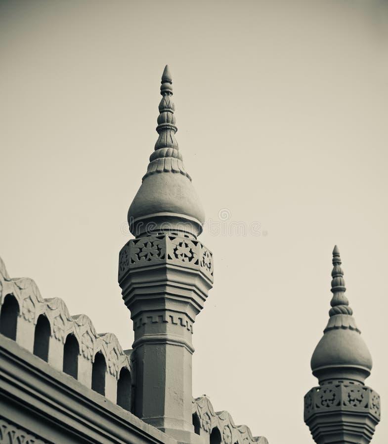 two minarets of a mosque unique photo stock images