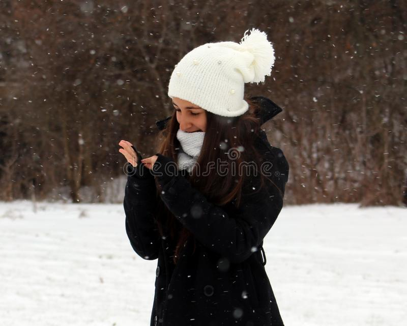 Beautiful confident green eyes teenager walking under snow while snowing. In Michigan. Gorgeous 14 years old teen. Happy smiling daughter royalty free stock photography