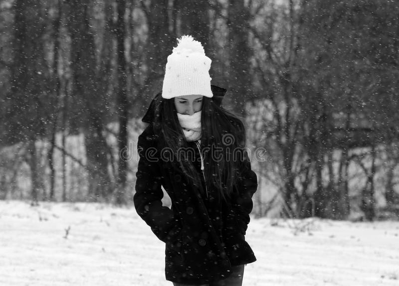 Beautiful confident green eyes teenager walking under snow while snowing. In Michigan. Gorgeous 14 years old teen. Happy smiling daughter royalty free stock photo