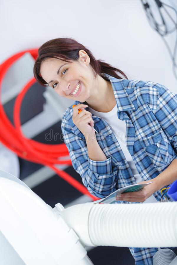 Beautiful and confident young female worker royalty free stock photography