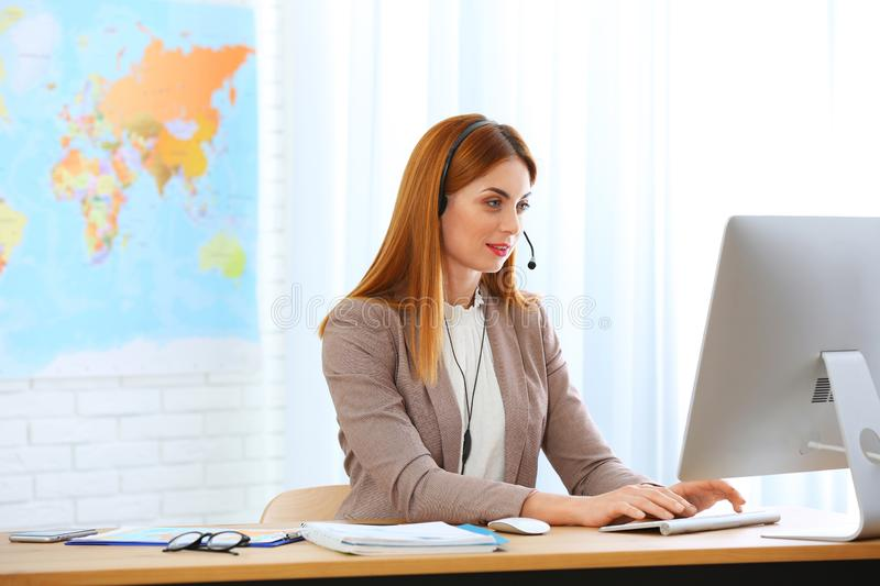 Beautiful consultant working with computer stock image