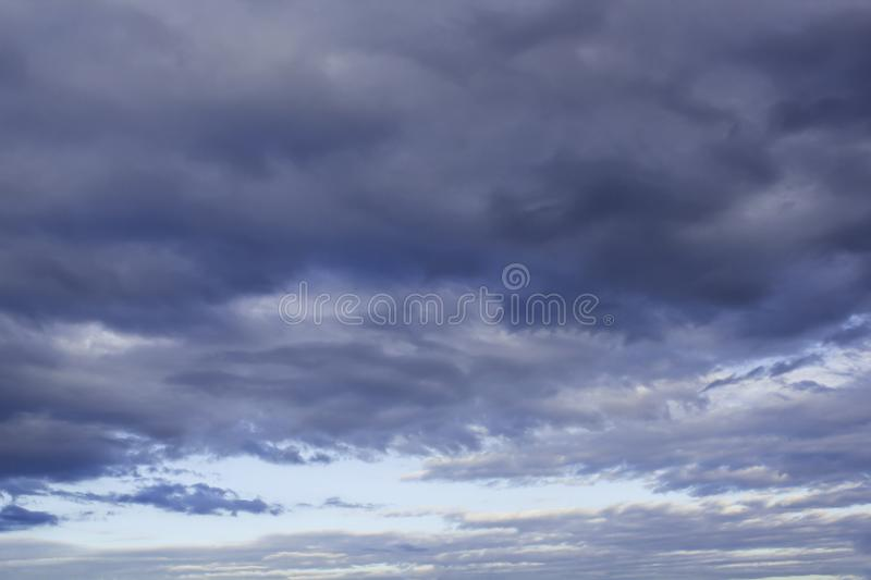 Beautiful contrast evening sky with grey thunder clouds texture stock photography