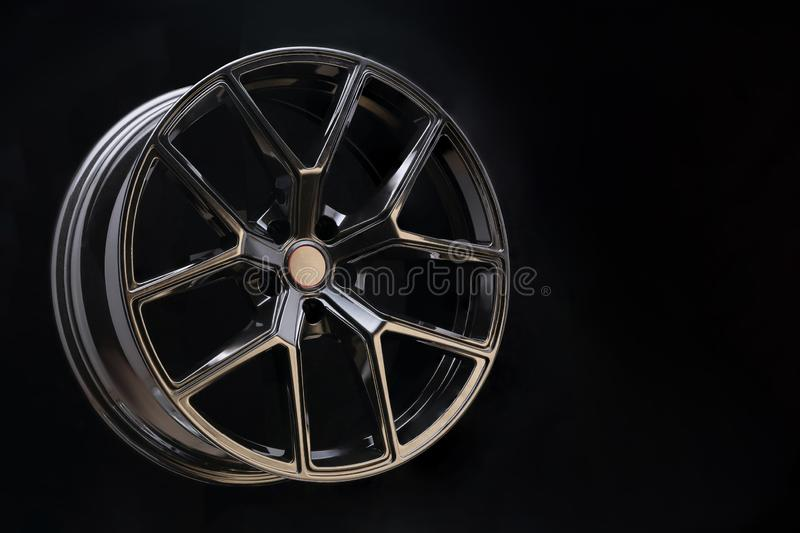 Beautiful and cool aluminum forged wheel, close-up. dark on black background, copyspace. sports style for auto racing and auto stock photos