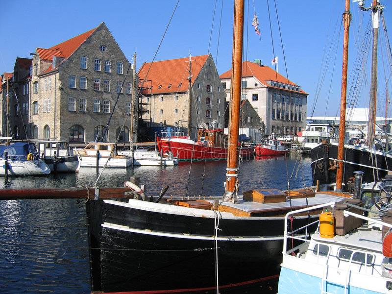Beautiful Copenhagen Denmark. Water canal, boats and houses royalty free stock photos