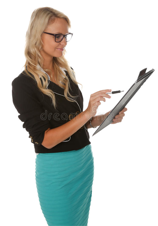 Beautiful Corporate Office Woman. Pretty young smiling office lady with pen and clipboard royalty free stock photography