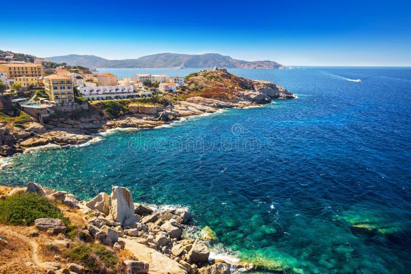 Beautiful Corsica coastline and historic houses in Calvi. View to beautiful Corsica coastline and historic houses in Calvi old town with turquoise clear ocean stock photo