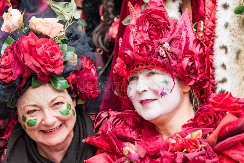 Costumed senior women with handmade dress full of roses and hearts at carnival in Zurich royalty free stock images