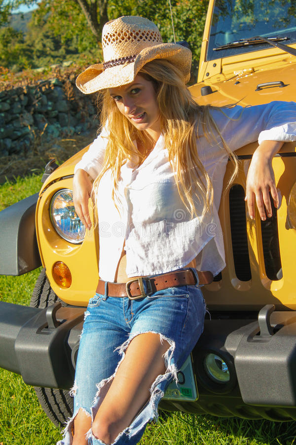 Beautiful Country Girl Posing On A Vehicle Stock Image -1351