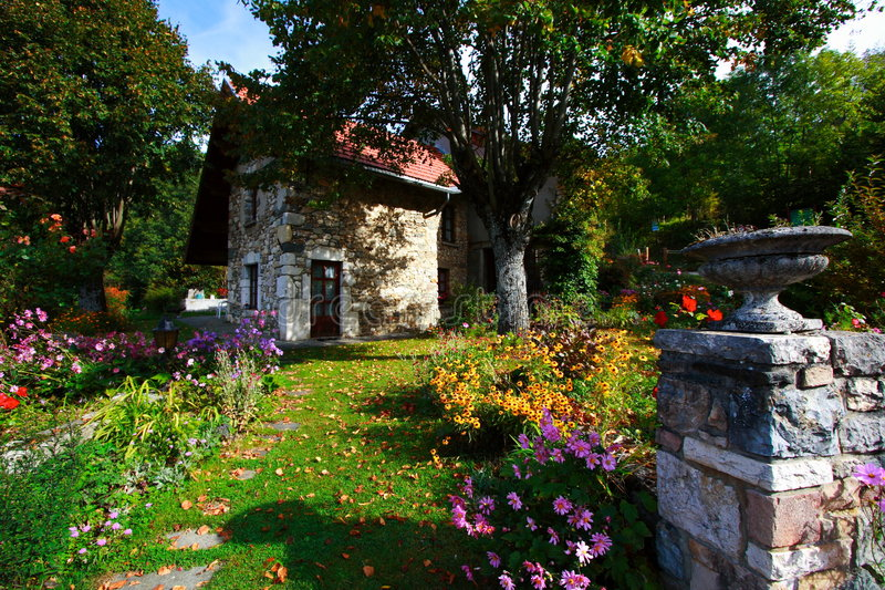 Beautiful country house. And its flowered garden in the the french countryside stock photography