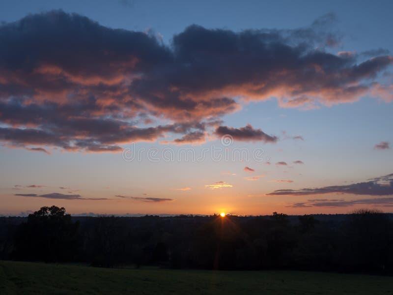 Beautiful country scene fields trees horizon sky red autumn sun royalty free stock photography