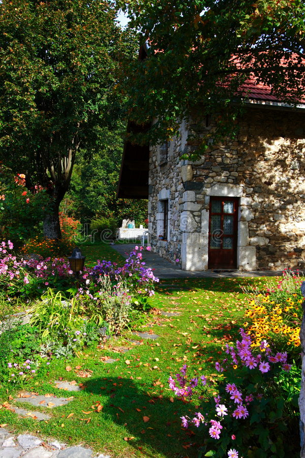 Beautiful country stone house. Beautiful country house and its flowered garden in the french countryside royalty free stock photography