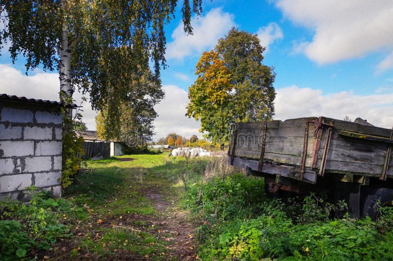 Beautiful country yard with utensils in autumn. Beautiful country yard with utensils in autumn royalty free stock photos