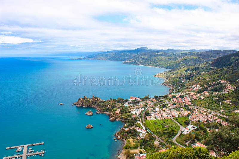 Beautiful countryside landscape around village Cefalu, Sicily, Italy located in a bay on the Tyrrhenian coast. Captured from above with the pier in the sea and stock image