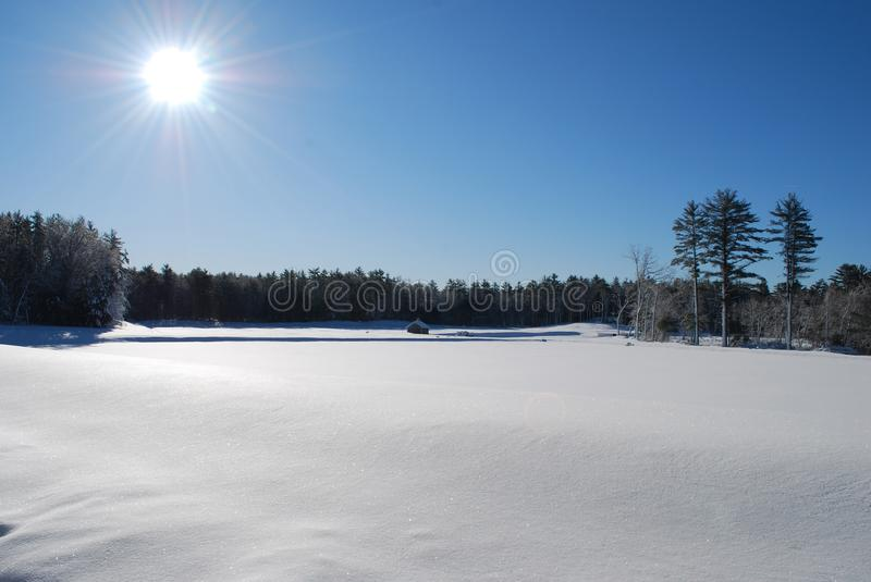 Cold countryside in the winter new england. Beautiful countryside snow covered field in new england royalty free stock image