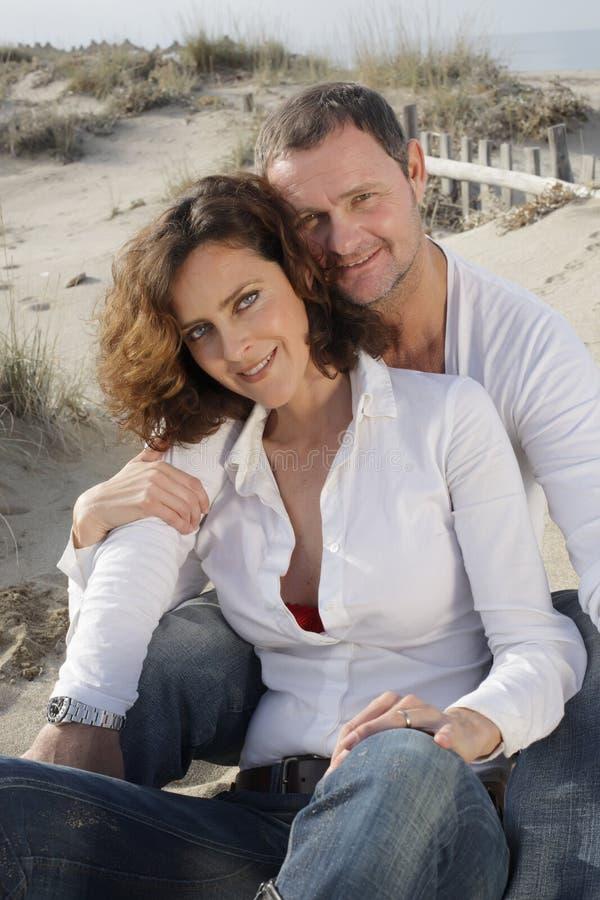 Beautiful couple. On the beach stock image
