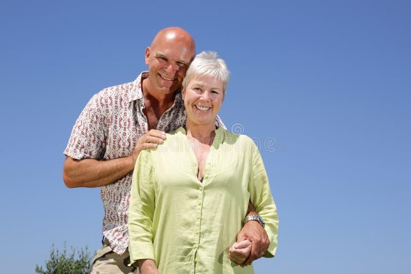 Beautiful couple. On sky background stock photography