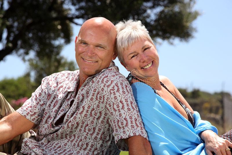 Beautiful couple. Beautiful mature couple relaxing outdoors royalty free stock images