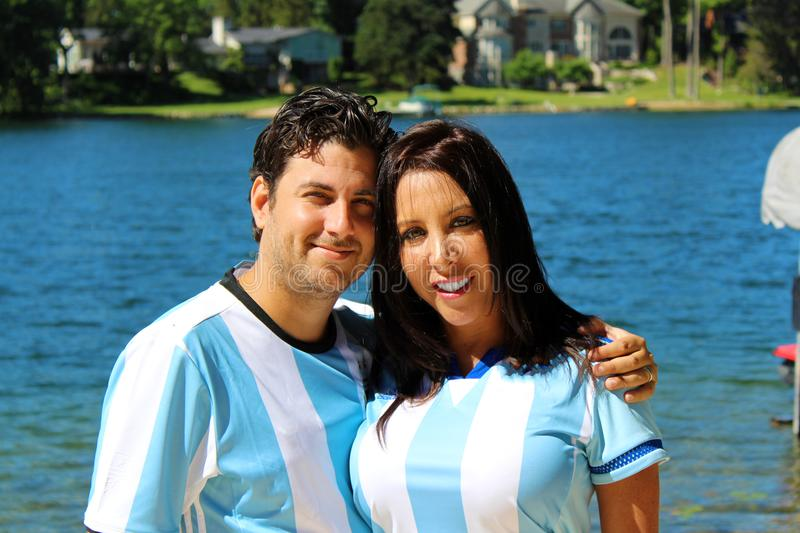 Beautiful couple with argentine jerseys celebrating soccer world cup 2018 royalty free stock image