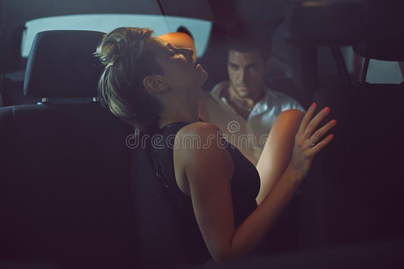 Beautiful couple on a car royalty free stock photos