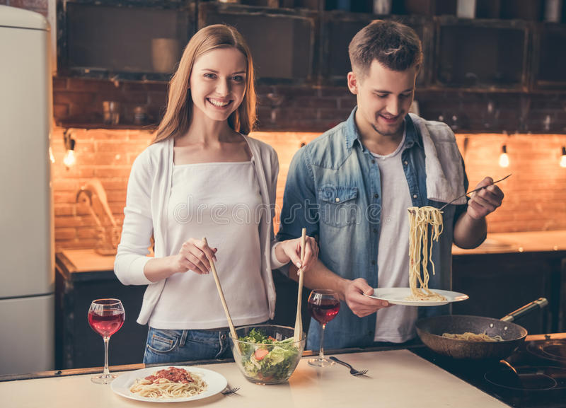 Beautiful couple cooking royalty free stock photography