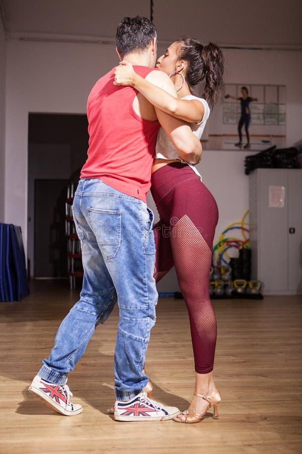 Beautiful couple dancing kizomba stock image