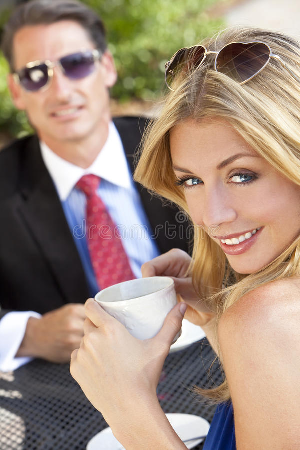 Beautiful Couple Drinking Coffee At Cafe stock photos