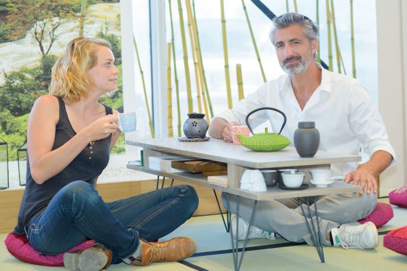 Beautiful couple drinking tea stock photo