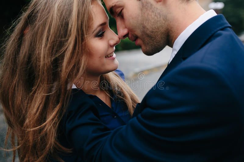 Beautiful couple in each other's arms stock photo
