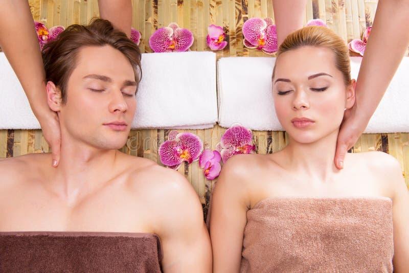 Beautiful couple enjoying head massage. royalty free stock image