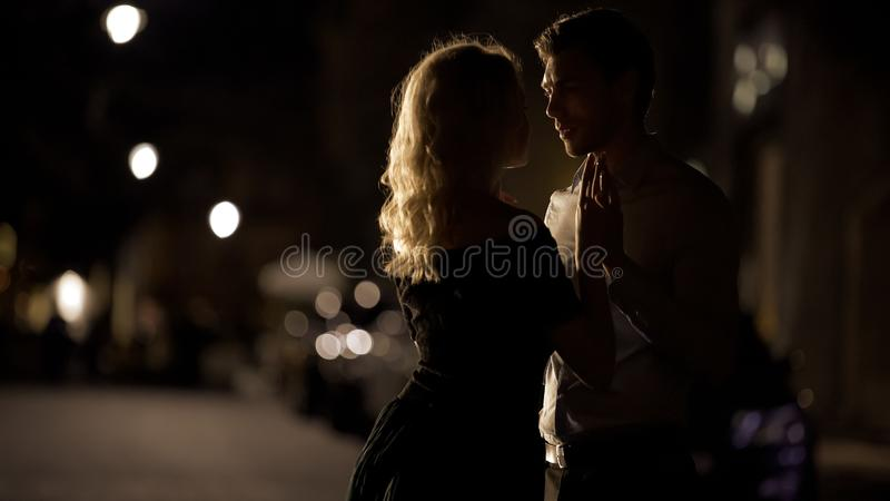 Beautiful couple holding hands and approaching to kiss, romantic date, love. Stock photo royalty free stock image