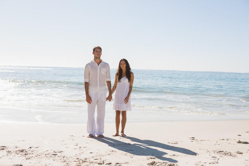 Download Beautiful Couple Holding Hands And Looking At Camera Stock Image - Image of freedom, dress: 33215265