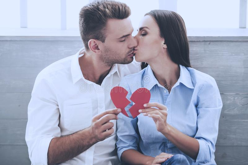 Beautiful Couple Holding Pieces of Paper Heart stock photos