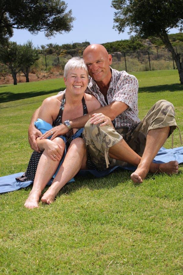 Beautiful couple on holidays. Beautiful mature couple relaxing outdoors stock image
