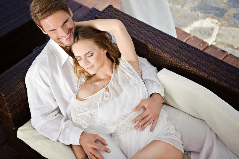 Beautiful couple in hug relaxing together. Portrait of beautiful young couple royalty free stock image