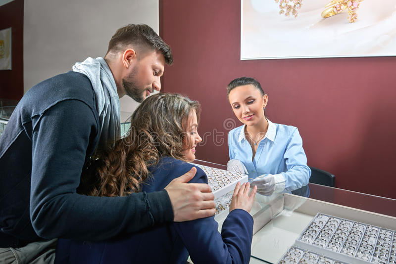 Beautiful couple at the jewelry store stock photography