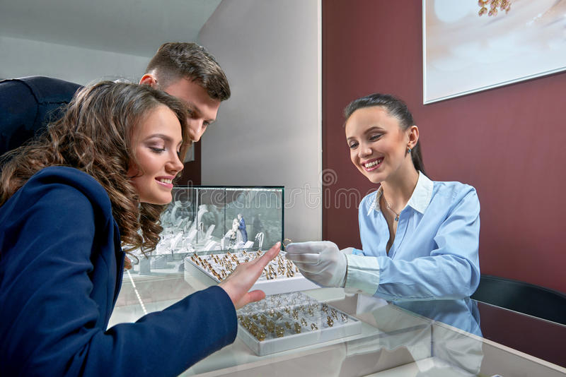 Beautiful couple at the jewelry store royalty free stock images