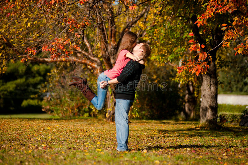 Download Beautiful Couple Kissing In Autumn Park Stock Image - Image: 21490659