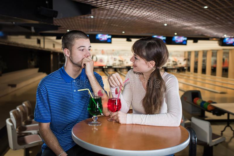Beautiful couple in love dating and bowling stock images
