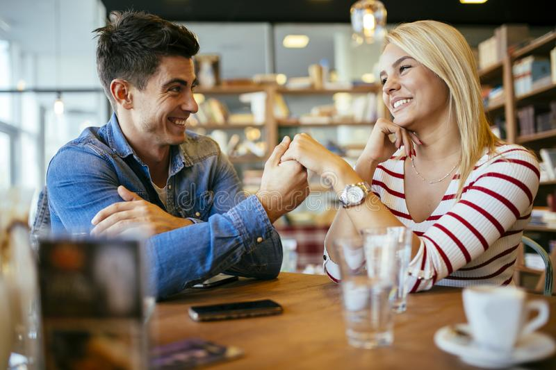Beautiful couple in love flirting in cafe stock photography