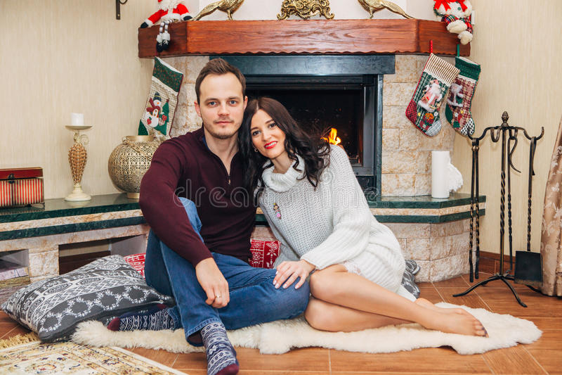 Beautiful couple in love near fireplace royalty free stock photos