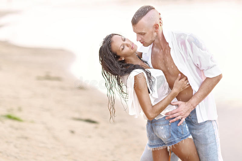 Beautiful Couple in love. On summer beach royalty free stock photos