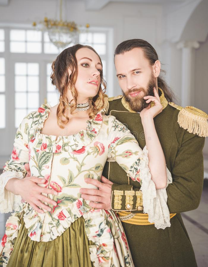 Beautiful couple man and woman in medieval costumes stock image